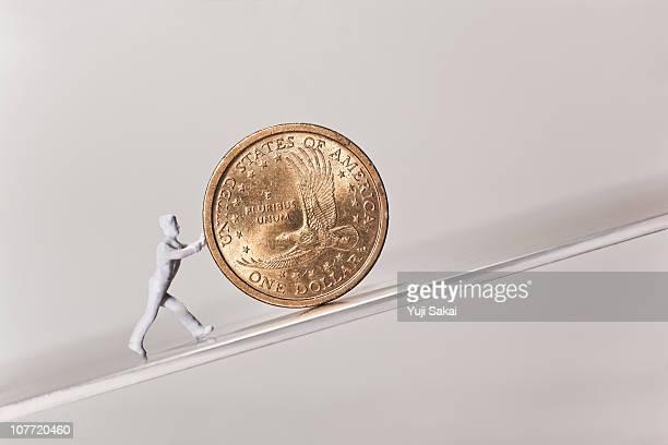 Figure pushing US 1 dollar