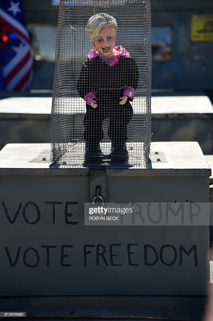A figure representing Democratic presidential candidate Hillary Clinton is seen before the start of a campaign rally by Republican presidential candidate Donald Trump at the Prescott Valley Event Center, October 4, 2016 in Prescott Valley, Arizona. / AFP / ROBYN