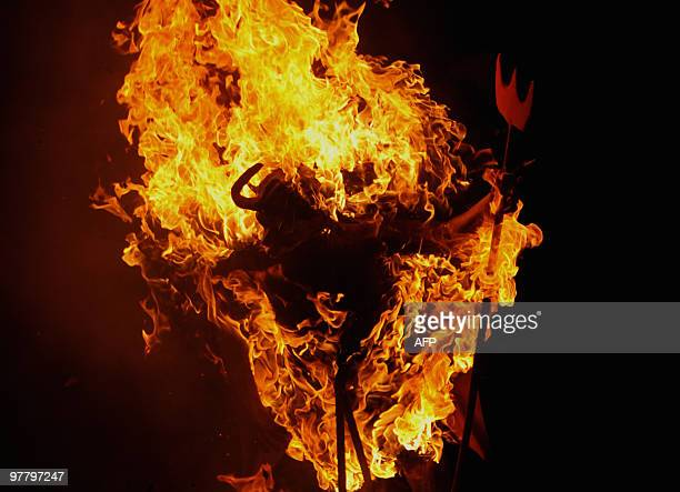 A figure representing the Devil burns on December 7 in Antigua Guatemala some 45 kilometers south west of Guatemala City before the Day of the Virgin...