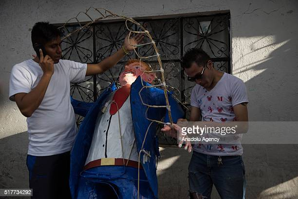 A figure representing US Republican presidential candidate Donald Trump is prepared before being burned during the Saturday of Glory as part of Holy...