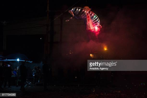 A figure representing US Republican presidential candidate Donald Trump is burned during the Saturday of Glory as part of Holy Week celebration in...