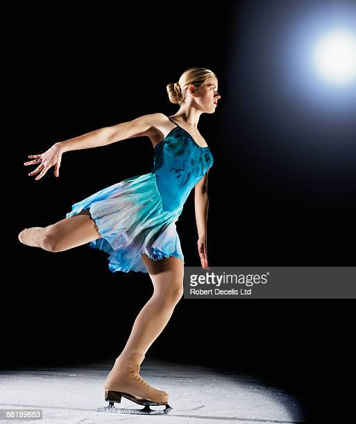 figure skater about to perform jump. - ice skating stock pictures, royalty-free photos & images
