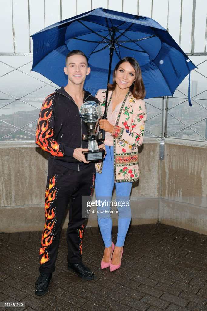 Figure skater Adam Rippon (L) and dancer Jenna Johnson pose together for a photo to celebrate the 'Dancing With The Stars' Finale at The Empire State Building on May 22, 2018 in New York City.