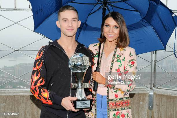 Figure skater Adam Rippon and dancer Jenna Johnson pose together for a photo to celebrate the 'Dancing With The Stars' Finale at The Empire State...