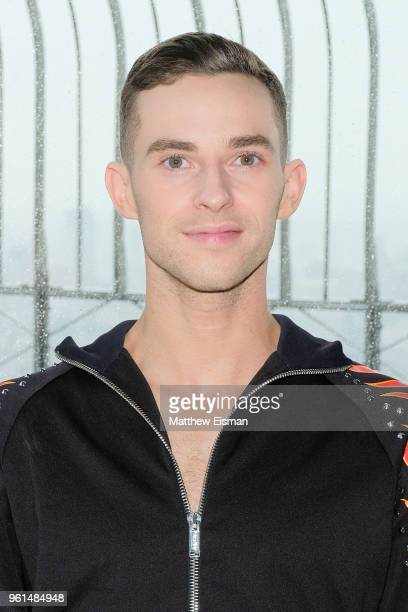 Figure skater Adam Rippon poses for a photo to celebrate the 'Dancing With The Stars' Finale at The Empire State Building on May 22 2018 in New York...