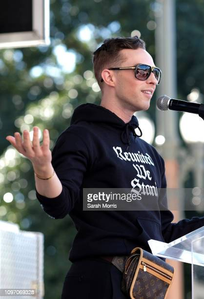 Figure skater Adam Rippon speaks at the Women's March California 2019 on January 19 2019 in Los Angeles California Demonstrations are slated to take...