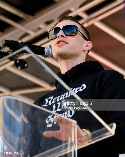 Figure skater Adam Rippon speaks during the 2019 Women's March Los Angeles on January 19 2019 in Los Angeles California