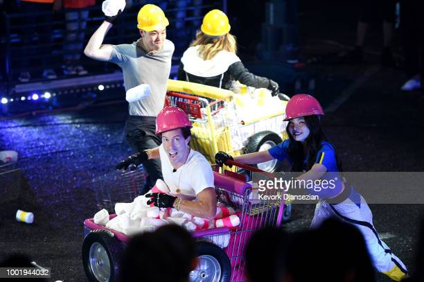 Figure skater Alex Shibutani snowboarder Shaun White and figure skater Maia Shibutani participate in a challange onstage during the Nickelodeon Kids'...