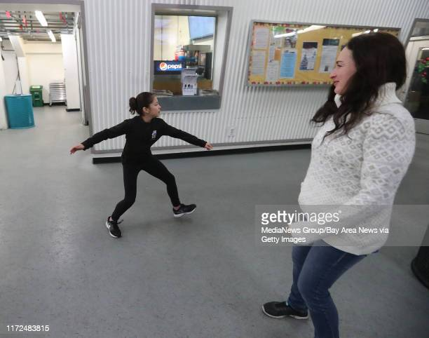 Figure skater Alysa Liu left warms up in the lobby of the Oakland Ice Center with her coach Laura Lipetsky right on Monday Dec 11 in Oakland Calif