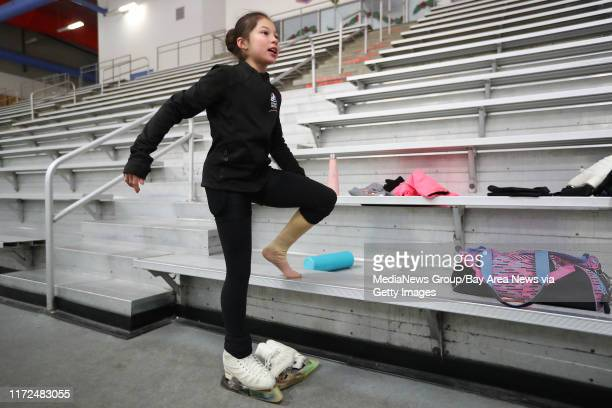 Figure skater Alysa Liu removes her skates after a practice session at the Oakland Ice Center on Monday Dec 11 in Oakland Calif