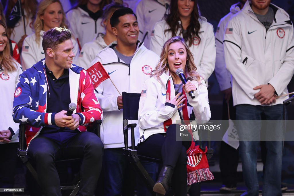 Figure skater Ashley Wagner answers questions as skier Gus Kenworthy looks on during the 100 Days Out 2018 PyeongChang Winter Olympics Celebration - Team USA in Times Square on November 1, 2017 in New York City.