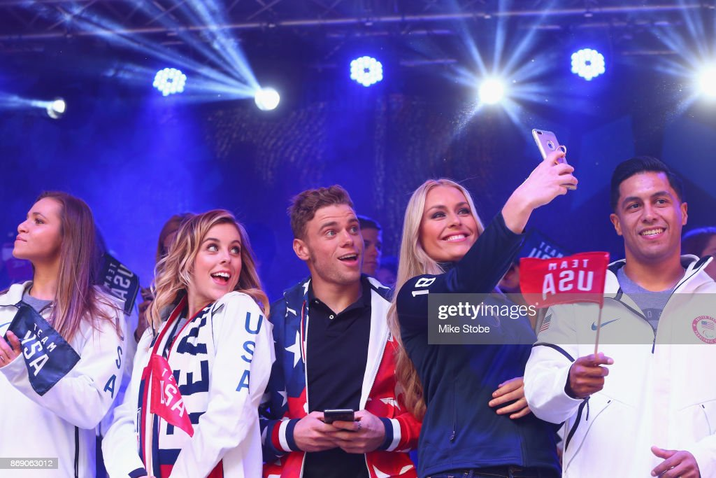 Figure skater Ashley Wagner, skier Gus Kenworthy and skier Lindsey Vonn take a selfie during the 100 Days Out 2018 PyeongChang Winter Olympics Celebration - Team USA in Times Square on November 1, 2017 in New York City.
