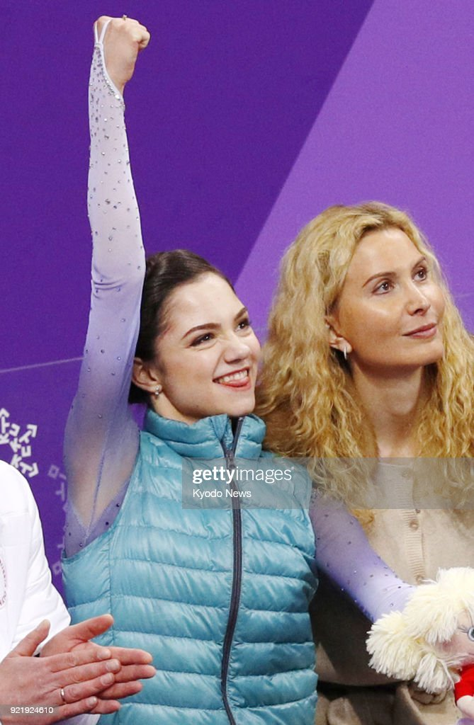 Figure skater Evgenia Medvedeva (L), an Olympic Athlete from Russia, pumps her fist after seeing her short program score in Gangneung, South Korea, at the Pyeongchang Winter Olympics on Feb. 21, 2018. ==Kyodo