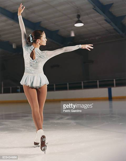 figure skater holding pose - figure skating stock pictures, royalty-free photos & images