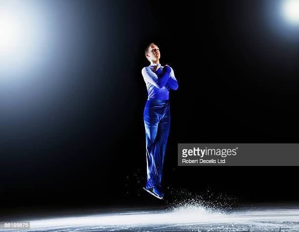 Figure skater in mid  air  jumping.