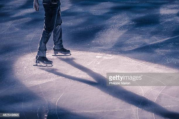 figure skater in the spot light - ice skate stock pictures, royalty-free photos & images