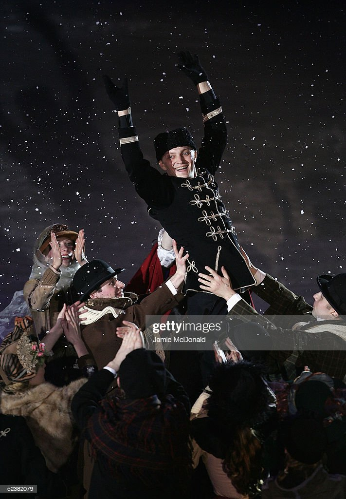 A figure skater is lifted up by the crowd of actors at the opening ceromony during the ISU World Figure Skating Championships at the Lunzhiki Sports Palace on March 13, 2005 in Moscow, Russia.
