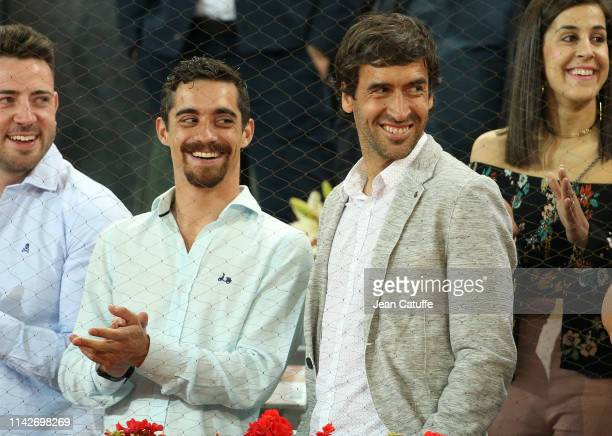 Figure skater Javier Fernandez and former footballer of Real Madrid Raul Gonzalez Blanco attend the victory of Rafael Nadal of Spain during day 7 of...