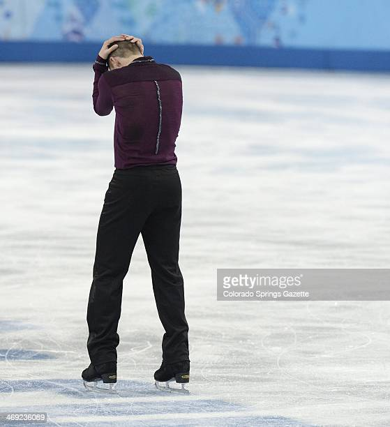 US figure skater Jeremy Abbott buries his head in his hands as he leaves the ice following his short program at the Iceberg Skating Palace in the...