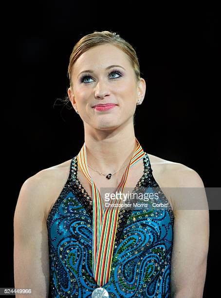 Figure skater Joannie Rochette of Canada, displays her silver medal after finishing second in the Ladies Free Skate during the ISU Four Continents...