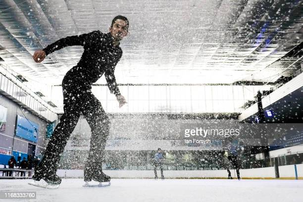 Figure skater John Kerr seven times UK National Champion and Bronze medallist at the European Championships sprays ice as he comes to a stop during...