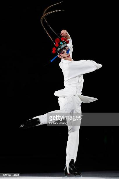 Figure Skater Johnny Weir performs during the 2014 Artistry On Ice Beijing at Beijing MasterCard Center on July 25 2014 in Beijing China