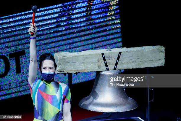 Figure skater Johnny Weir rings the game bell before a game between the Philadelphia 76ers and the Oklahoma City Thunder at Wells Fargo Center on...