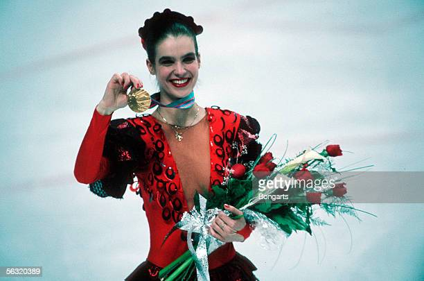 Figure skater Katarina Witt of German Democratic Republic is seen with her gold medal on February 27, 1988 in Calgary, Canada.