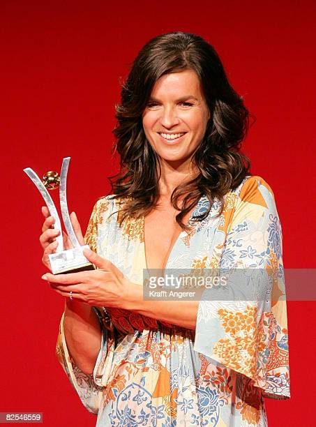 Figure skater Katarina Witt poses with the award at the Sport Bild Award 2008 at the Elb Lounge August 25, 2008 in Hamburg, Germany.