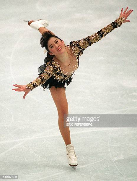 Figure skater Kristi Yamaguchi from the United States smiles as she performs during the women's free program at the Winter Olympic Games 21 February...