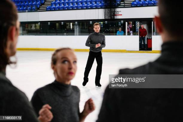 Figure skater Mark Hanretty joins other skaters as they perform during final rehearsals for the world premiere ice skating performance of The...