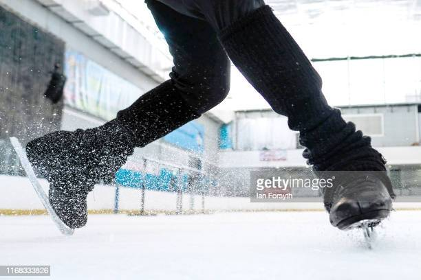 Figure skater Mauro Bruni slides to a stop during final rehearsals for the world premiere ice skating performance of The Creative Spirit of John...