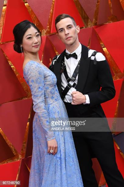 US figure skater Mirai Nagasu and US Olympic medalist Adam Rippon arrive for the 90th Annual Academy Awards on March 4 in Hollywood California / AFP...