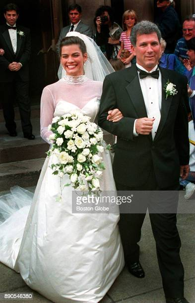 Figure skater Nancy Kerrigan and her new husband Jerry Solomon leave the church following their wedding in Boston on Sep 9 1995