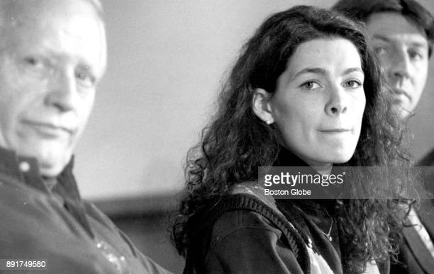 Figure skater Nancy Kerrigan is pictured during a press conference at the Radisson Hotel in Woburn MA on Jan 17 1994 Coach Evy Scotvold sits at left...