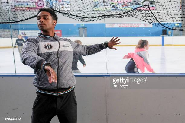 Figure skater Oscar Peter warms up as a public skating session takes pace behind him during final rehearsal preparations for the world premiere ice...