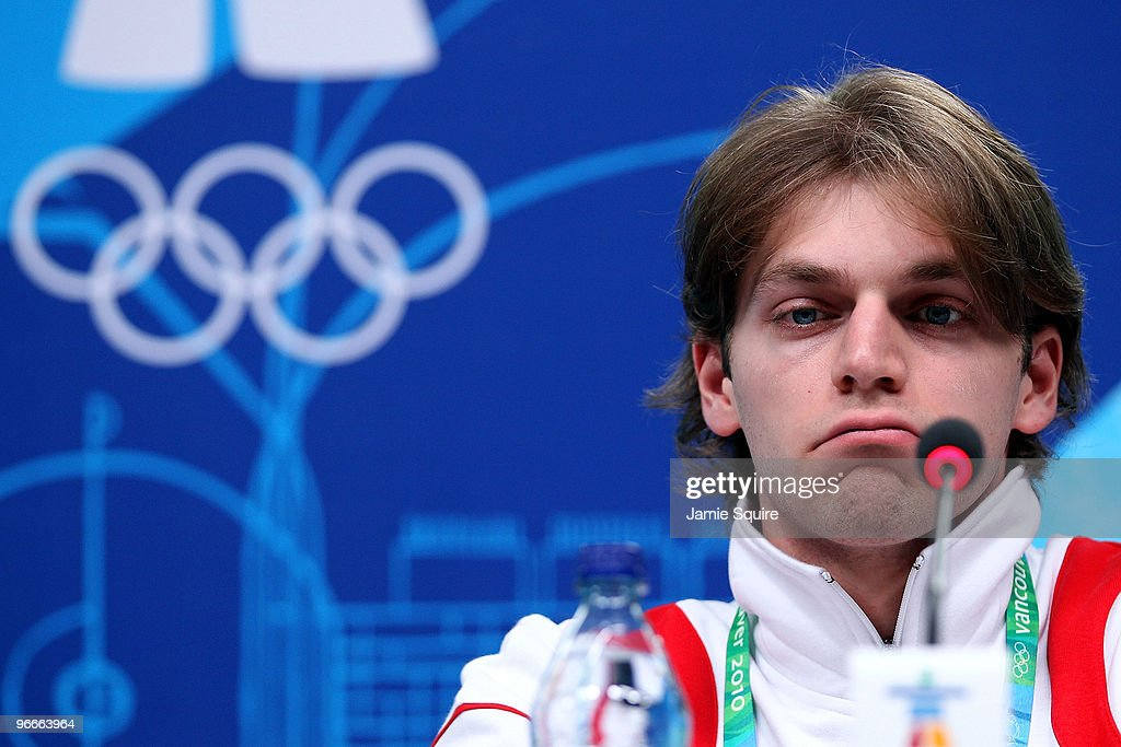 Figure skater Otar Japaridze of Georgia looks on as president Mikheil Saakashvili speaks during a press conference at the MPC on day two of the Vancouver 2010 Winter Olympics on February 13, 2010 in Vancouver, Canada. Saakashvili spoke about the recent death of fellow countrymen Nodar Kumaritashvili who was killed after crashing during a luge training run on February 12th at the Whistler Sliding Center.