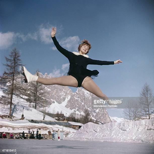 'A figure skater performing a jump during the VII Olympic Winter Games Cortina d'Ampezzo 1956 '