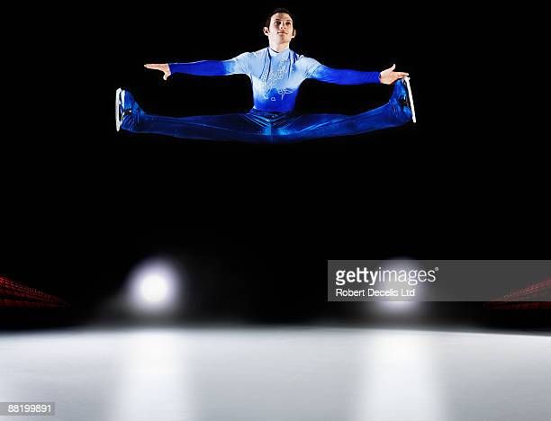 figure skater performing jump. - figure skating stock pictures, royalty-free photos & images