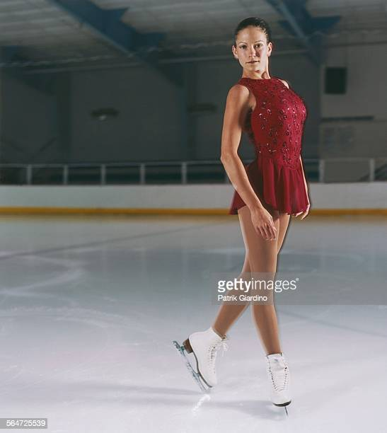 figure skater posing on ice - figure skating stock pictures, royalty-free photos & images