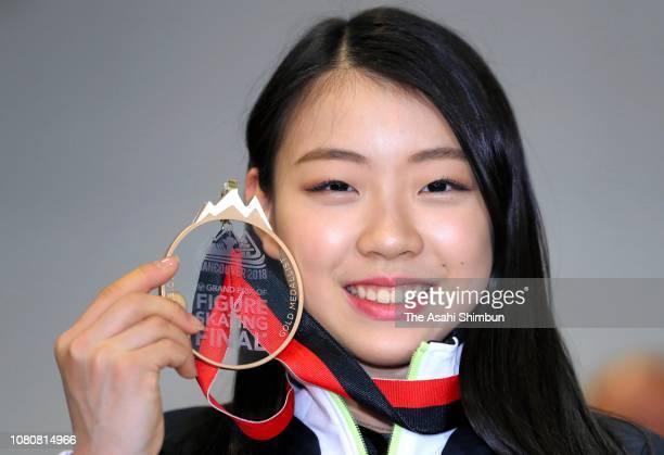 Figure skater Rika Kihira poses for photographs on arrival at Narita International Airport on December 11 2018 in Narita Chiba Japan