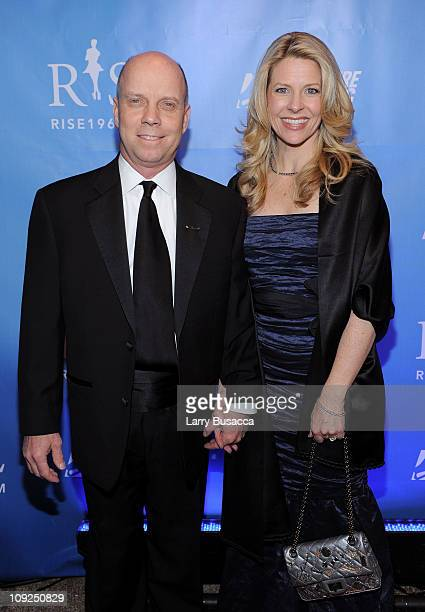 Figure Skater Scott Hamilton and Tracie Hamilton attend the New York premiere Of RISE at Best Buy Theater on February 17 2011 in New York City