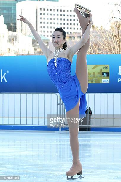 Figure skater Shizuka Arakawa the 2006 Turin Winter Olympics figure skating gold medalist performs during the opening ceremony for the Citi Ice Rink...