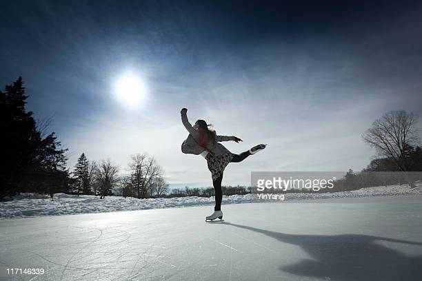 Figure Skater Skating Against Sun on Winter Pond Ice Rink