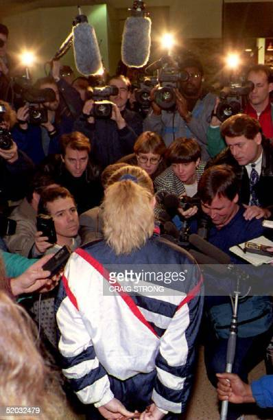 S figure skater Tonya Harding answers questions from reporters after her first recent public skating session 20 January 1994 amid allegations that...