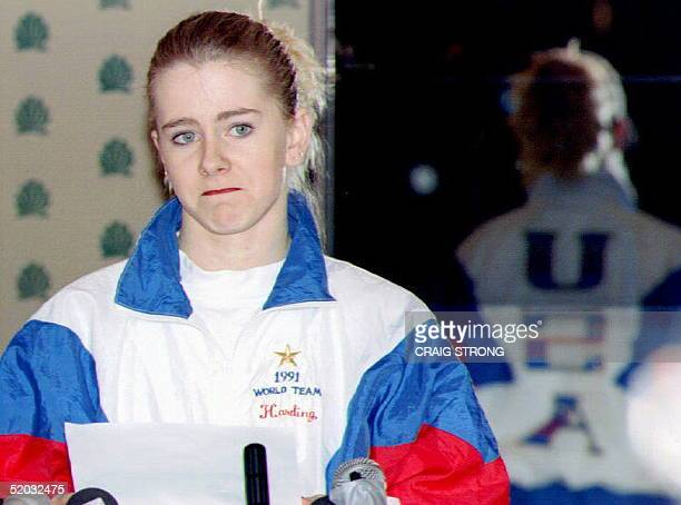 S figure skater Tonya Harding reads from a prepared text 27 January 1994 during a press conference at the Multnomah County Athletic Club Oregon...