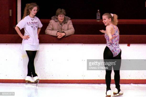 S figure skater Tonya Harding skates near mother Sandy Golden and training partner Angela Meduna during a workout 21 January 1994 as allegations...