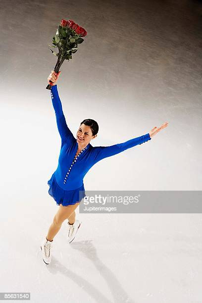 Figure skater with bouquet of roses