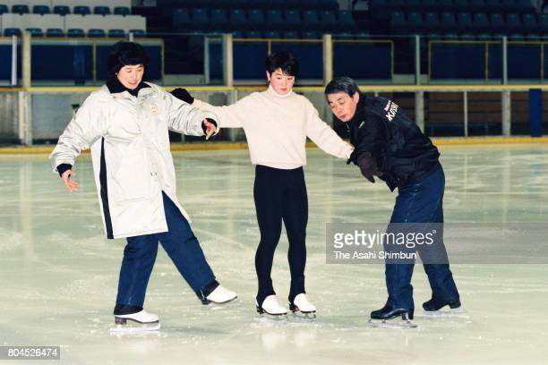 Figure skater Yuka Sato is instructed by his father and coach Nobuo Sato during a training session on January 21 1994 in Yokohama Kanagawa Japan
