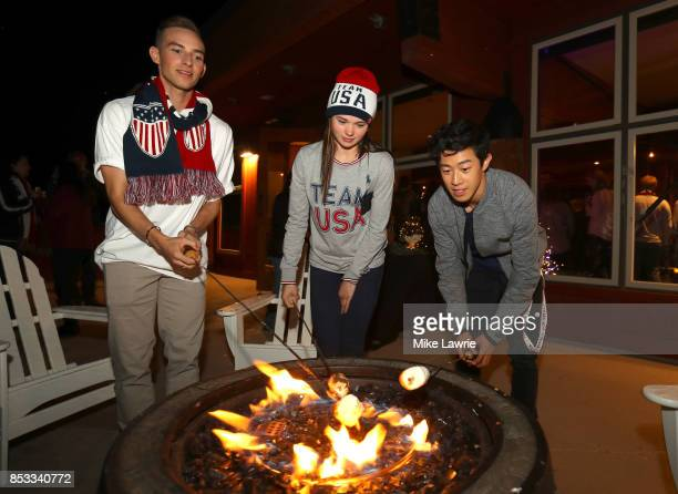 Figure skaters Adam Rippon Mariah Bell and Nathan Chen make smores during the Team USA Media Summit opening reception at the Red Pine Lodge on...